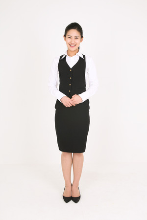 A female waitress bowing with smile