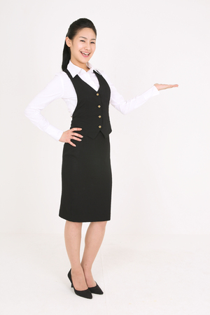 A female waitress with hand gesture Stock Photo