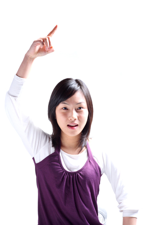 A young woman raising a hand as pointing Stok Fotoğraf - 83153805