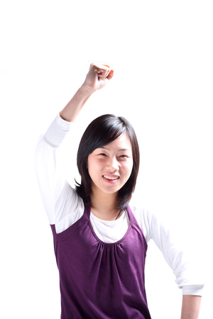 A young woman raising a hand