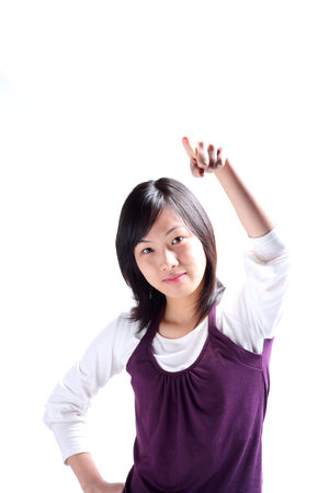 A young woman raising a hand as pointing