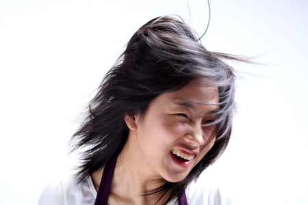 Close up shot of a woman in twenties banging head