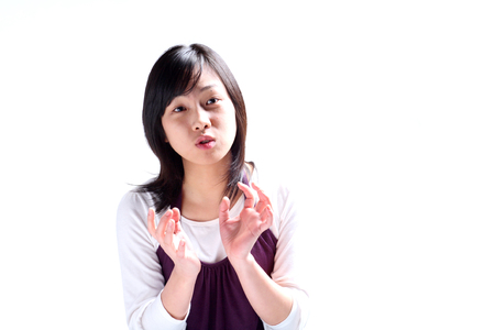 A young woman explaining with hand gesture