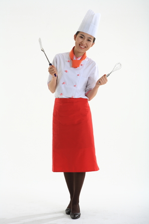 A female cook holding cooker cooking tool Stock Photo