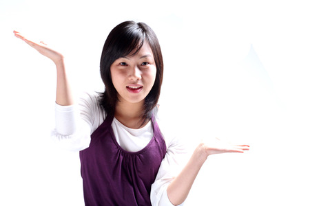 Close up shot of a young woman shrugging shoulders Stock Photo