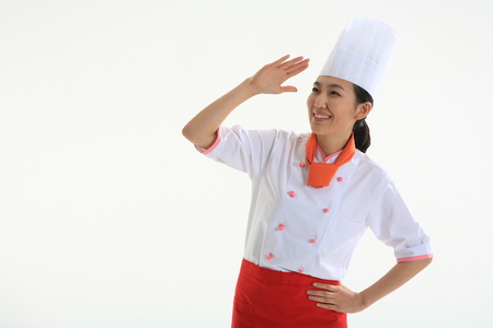 Chestshot of a female cook looking far awary with a hand Stock Photo