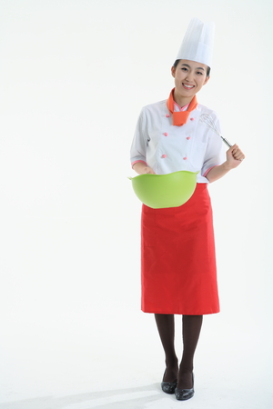 korean salad: A female cook holding cooker cooking tool Stock Photo