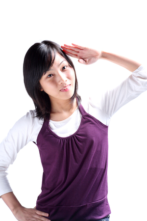 A young woman giving hand salute