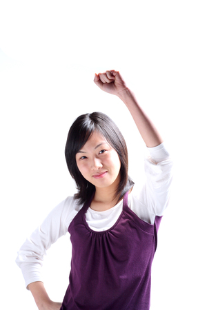 black cheerleader: A young woman raising a hand
