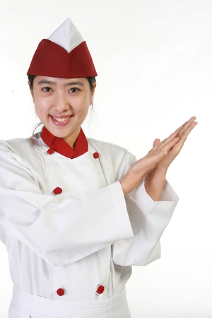 Close up shot of a female patissier showing empty hands as putting one on the other Stock Photo