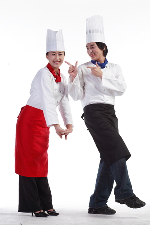 A couple of cooks in cute poses
