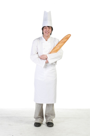 A male patisser holding a loaf of bread as crossing arms Stock Photo
