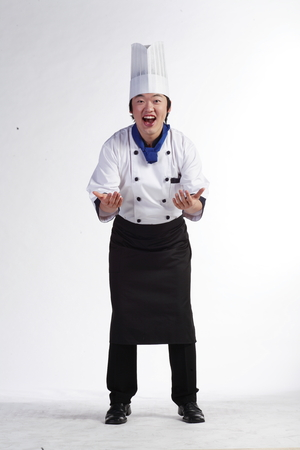A male cook showing open hands to the front