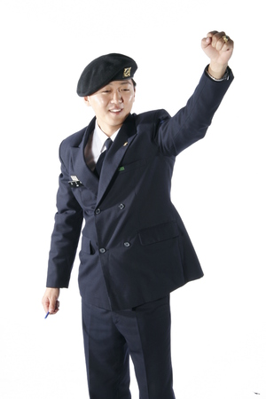 disciplined: A male soldier in a cheering pose with a fist up in the air Stock Photo