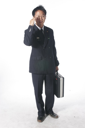 A male soldier wearing glasses in hand salute pose as holding a briefcase
