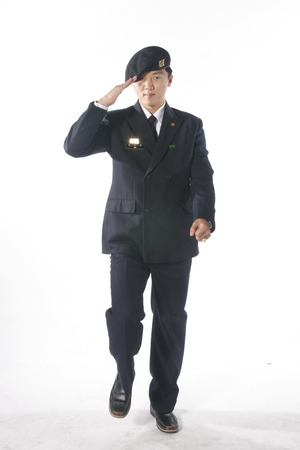 disciplined: A male soldier pretending to walk as doing a hand salute
