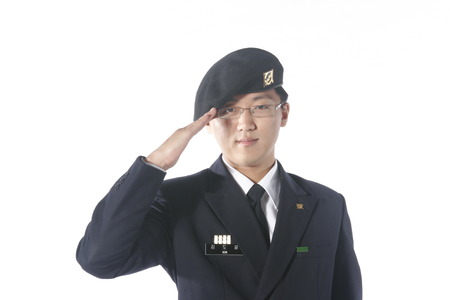 disciplined: Close up shot of a male soldier in hand salute pose