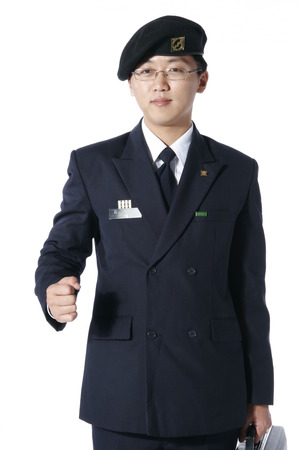 disciplined: A male soldier wearing glasses in a walking motion