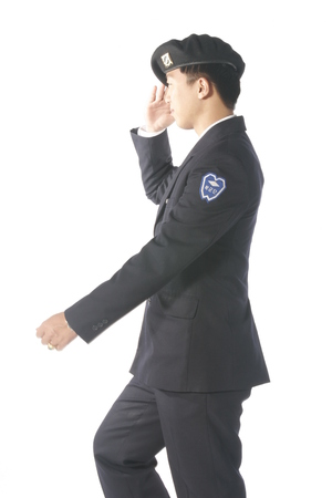 A male soldier pretending to walk as doing a hand salute