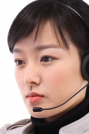 Close up shot of a face of a female telemarketer answering to the customer