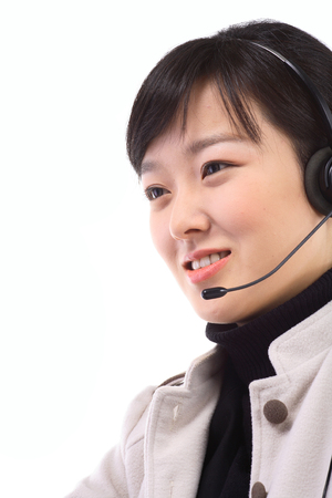 customer service representative: Close up shot of a face of a female telemarketer answering to the customer