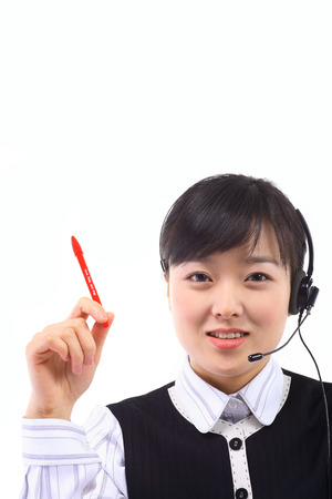 customer service representative: A female telemarketer holding a red pen as responding to the customer Stock Photo
