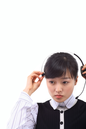 customer service representative: Close up shot of a femlae telemarketer fixing a mic of the headset