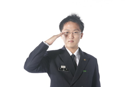 disciplined: Close up shot of a male soldier doing a hand salute without a hat on Stock Photo