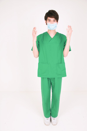 Full shot of A male surgeon wearing surgery mask with showing backhands to the front Stock Photo