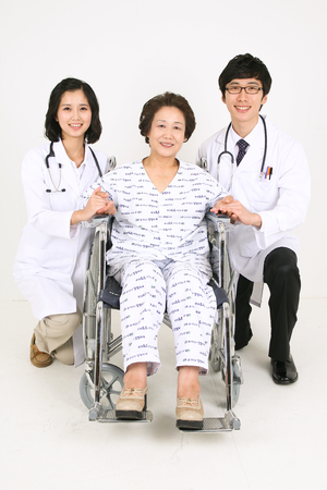 kind hearted: A couple of doctors holding hands with the senior patient