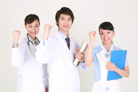 Close up shot of A couple of doctor and a female nurse showing fists to the front