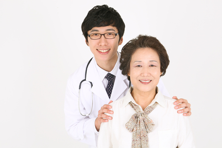 ortopedia: Close up shot of a male doctor putting arms around the senior patient
