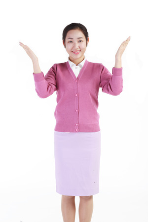 A female hospital coordinator showing empty hands as standing Stock Photo