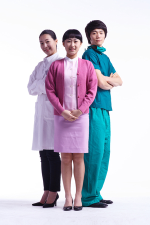 Full shot of Group photo: A female doctor, nurse and a male surgeon standing together