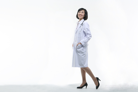 Full shot of A female doctor in walking motion as putting hands in pocket