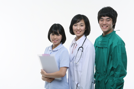 Close up shot of A female nurse, doctor and a male surgeon standing in a row