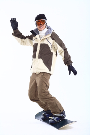 Front shot of A male snowboarder waving hand as snowboarding