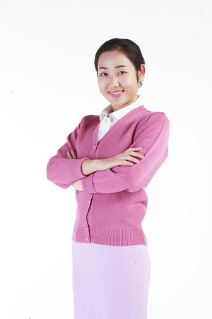A female hospital coordinator standing as crossing arms Stock Photo