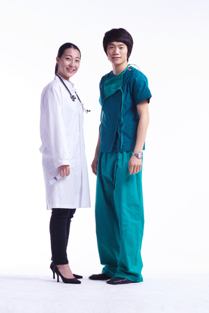 Full shot of A male surgeon and a female doctor standing straight Stock Photo