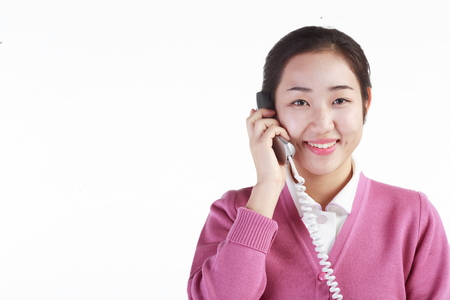 Close up shot of A female hospital coordinator answering the phone