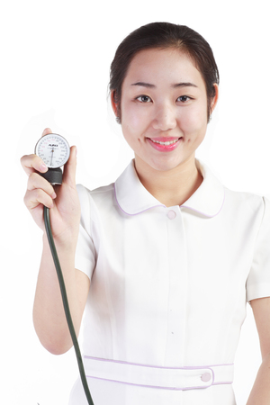 Close up shot of Isolated shot of a female nurse using a sphygmomanometer