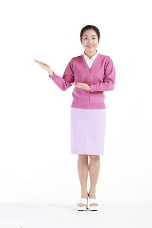 Full shot of A female hospital coordinator showing an empty hand to the side way Stock Photo