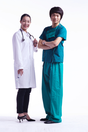 md: Full shot of A male surgeon and a female doctor standing straight Stock Photo