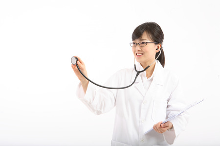 A female doctor pretending to apply the stethoscope as holding a patient chart in hand