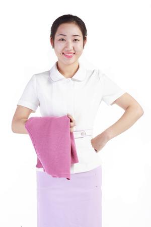 A female nurse holding jacket over arm Stock Photo