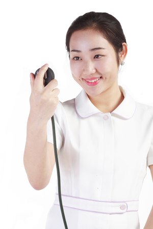 tonometer: Close up shot of Isolated shot of a female nurse using a sphygmomanometer