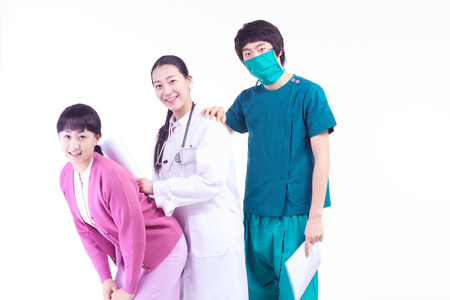 md: A female doctor, nurse and a male surgeon standing as leaning on each other in a row