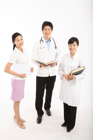 Full shot of A group of medical personnel holding books and a patient chart