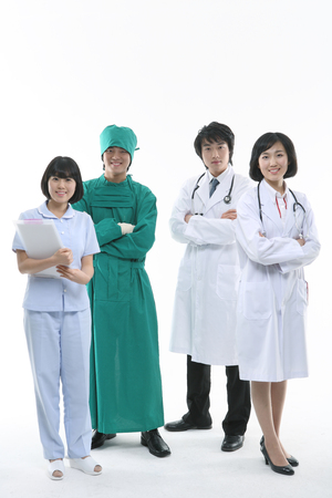 Full shot of A group of medical personnel standing as crossing arms