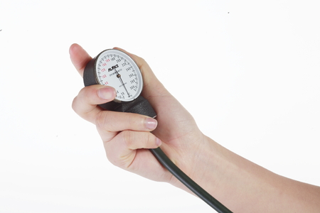 tonometer: Isolated shot of a sphygmomanometer being used by a female nurse